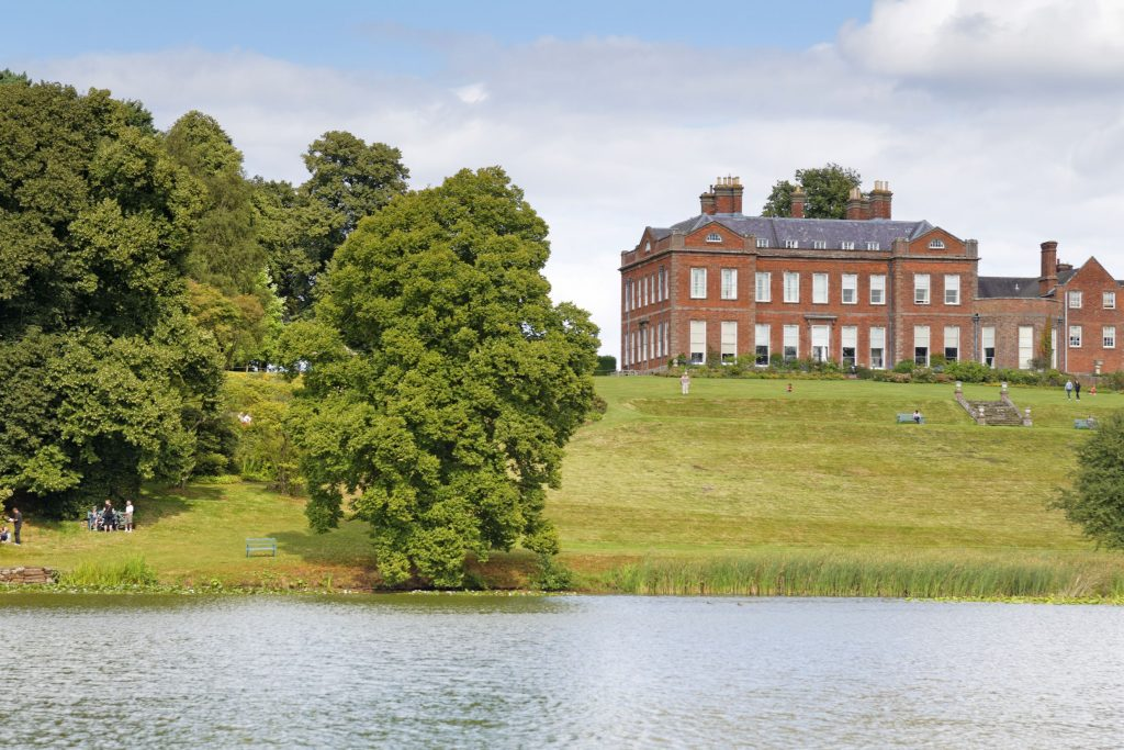 The house seen from across the Big Pool at Dudmaston Estate, Shropshire.